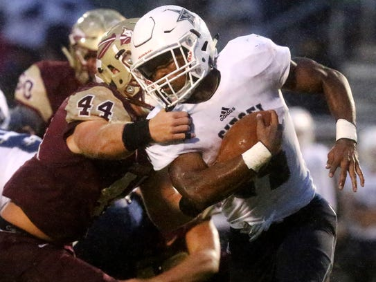 Siegel's Lelan Wihoite (44) runs the ball as Riverdale's