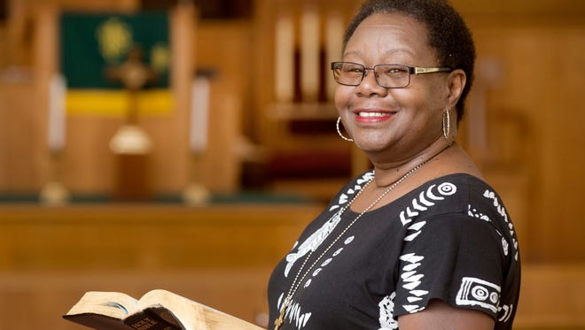 """In this Aug. 22, 2017 photo, the Rev. Margaret Redmond of the First African Methodist Episcopal Church stands in the church's sanctuary in Pueblo, Colo. """"If you look at the history of the AME churches, they were planted at the intersection of roads leading into town,"""" Redmond said. """"As America was moving westward, black people could always find a place to sleep, eat and to find jobs at the churches."""" (Bryan Kelsen/The Pueblo Chieftain via AP)"""