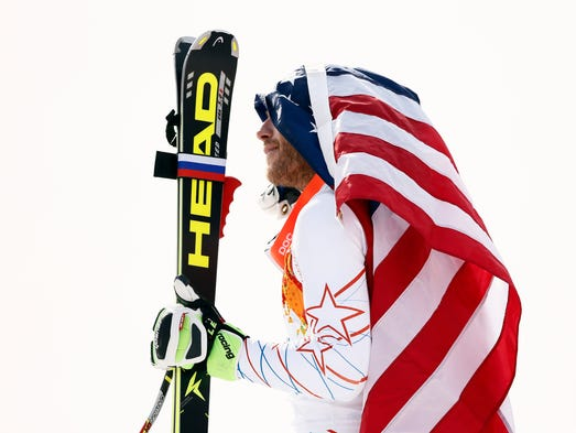 Bode Miller (USA) celebrates winning bronze in men's alpine skiing super-G during the Sochi 2014 Olympic Winter Games at Rosa Khutor Alpine Center.