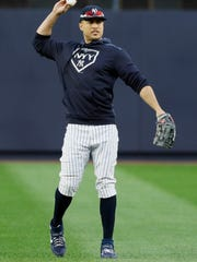 New York Yankees left fielder Giancarlo Stanton warms up during batting practice before Game 4 of baseball's American League Championship Series against the Houston Astros Thursday, Oct. 17, 2019, in New York. (AP Photo/Matt Slocum)