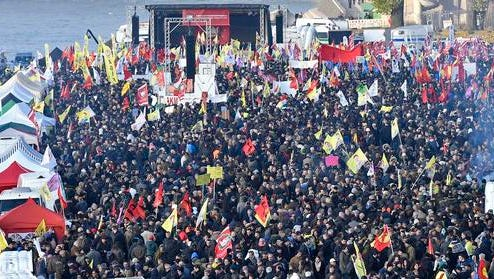 Pro-Kurdish  demonstrators protest  against Turkish president Recep Tayyip Erdogan and the political repression that followed July's failed military coup,  in Cologne, Germany Saturday, Nov. 12, 2016.