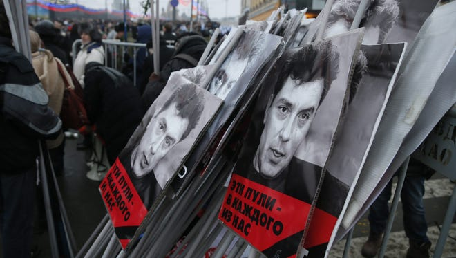 Portraits of murdered Russian opposition veteran leader Boris Nemtsov are stacked at the end of the march in his memory in central Moscow on March 1, 2015.