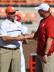 Clemson head coach Dabo Swinney and North Carolina State head coach Dave Doeren during pre-game on Saturday, October 15, 2016 at Clemson's Memorial Stadium.