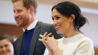 Prince Harry and Meghan Markle were all smiles during a visit to Catalyst Inc. Science Park in Belfast, Ireland.