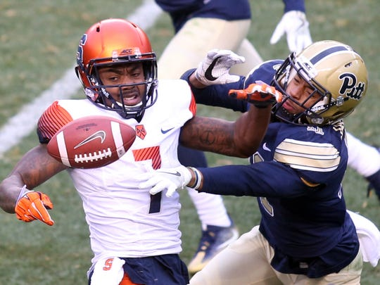 Nov 26, 2016; Pittsburgh, PA, USA;  Pittsburgh Panthers defensive back Dane Jackson (right) breaks up a pass intended for Syracuse Orange wide receiver Amba Etta-Tawo (7) during the third quarter at Heinz Field. PITT won 76-61. Mandatory Credit: Charles LeClaire-USA TODAY Sports