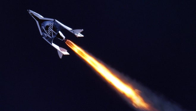 Virgin Galactic's first SpaceShipTwo during its first supersonic powered flight. This craft was destroyed, and its co-pilot killed, during a Oct. 31, 2014 test flight. Company officials on Friday are showing off the replacement craft they've built.