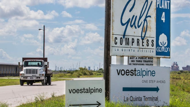 Signs on LaQuinta Terminal Road show the way Voestalpine Texas' Iron manufacturing plant near Portland.