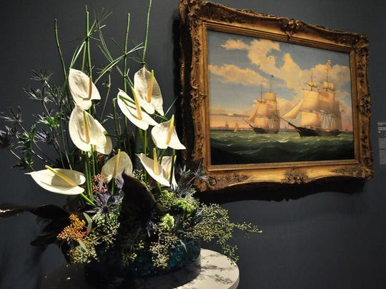An example of fresh flowers being paired with art at the Cincinnati Art Museum's annual Art in Bloom.