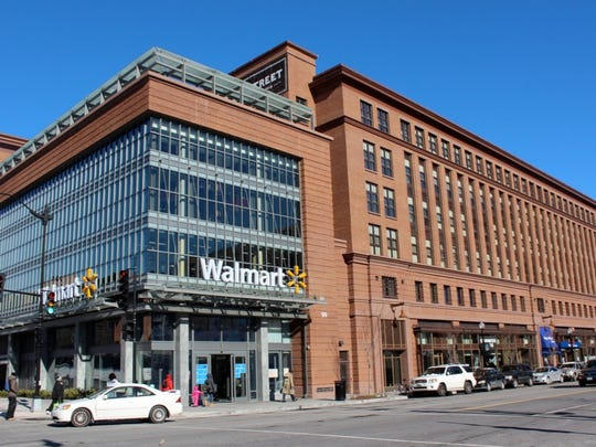 This new Washington, D.C. Wal-Mart features parking below and four stories of apartments above with a swimming pool on the roof.