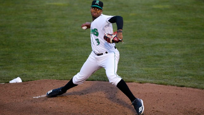 Dayton Dragons pitcher Hunter Greene (3) delivers a pitch in the top of the third inning of the MiLB game between the Dayton Dragons and the Lake County Captains at Fifth Third Field in Dayton, Ohio, on Monday, April 9, 2018. Greene, the Cincinnati Reds first-round draft pick, finished his three-inning Dragons debut with eight strikeouts on 50 pitches.