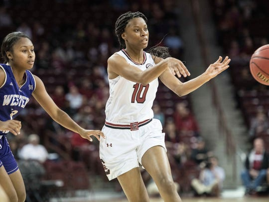 South Carolina guard Bianca Jackson (10) passes the ball against Western Carolina guard Nikki Johnson, left, during the first half of an NCAA college basketball game Thursday, Nov. 30, 2017, in Columbia, S.C. South Carolina defeated Western Carolina 101-43. (AP Photo/Sean Rayford)