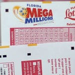 Cards to pick numbers for Mega Million lottery tickets are seen at Circle News Stand on Dec. 16, 2013 in Hollywood, Florida.