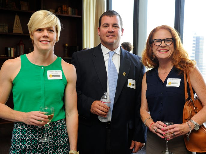 Chandra Garrison, Richard Perko and Amy Cathey at The Tennessean's Top Workplaces reception at the Nashville City Club.