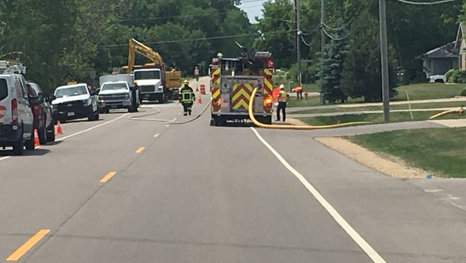 Grand Chute firefighters respond to a natural gas leak at the intersection of North Casaloma Drive and West Capitol Drive Thursday afternoon.
