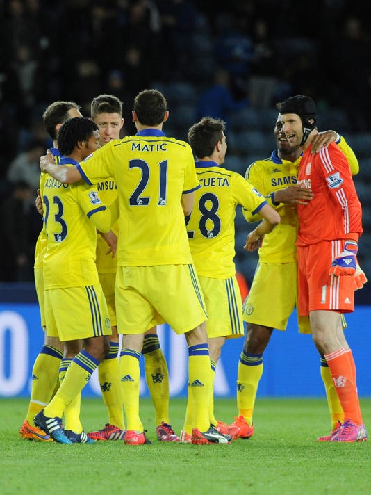 Chelsea players celebrate after beating Leicester 3-1 during the English Premier League soccer match at the King Power Stadium, Leicester, England Wednesday, April 29, 2015. (AP Photo/Rui Vieira)