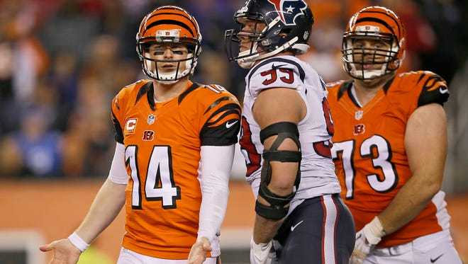 Cincinnati Bengals quarterback Andy Dalton (14) questions a penalty in the fourth quarter during the game against the Houston Texans. The Bengals fell to 8-1, with a 10-6 loss to the Texans.
