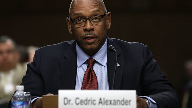 In this Dec. 9, 2014 photo, Cedric Alexander, president of the National Organization of Black Law Enforcement Executives and public safety director of DeKalb County, Georgia, testifies before the Senate Judiciary Committee's Constitution, Civil Rights and Human Rights Subcommittee.