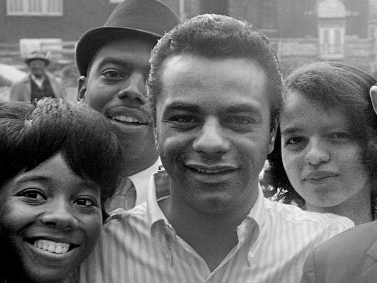 Johnny Mathis is flanked by fans in Nashville on March 2, 1965.