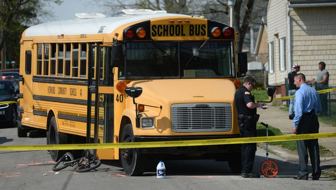 Richmond Police officers investigate an accident Tuesday, April 19, 2016, where a school bus struck a juvenile riding a bicycle near Ridge Street and N.W. I Street in Richmond.
