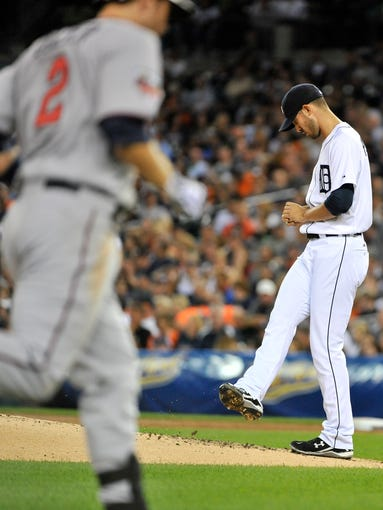 Detroit Tigers' Rick Porcello reacts while the Minnesota Twins' Brian Dozier rounds the bases on his solo home run in the third inning of a Major League Baseball game at Comerica Park in Detroit on Aept. 26, 2014. The Twins won 11-4.
