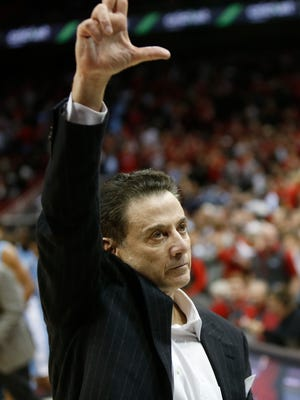 "Louisville coach Rick Pitino flashes the ""L"" after his team's victory over UNC. Feb. 1, 2016."