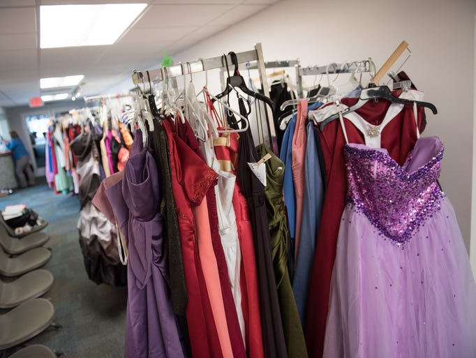 Dresses hang at the Prom Blessing Closet at William