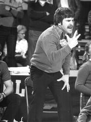 1982: Wrestling Coach Brad Smith reacts to the match.