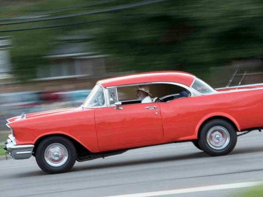A red hot cruiser rolls down Woodward on Friday.