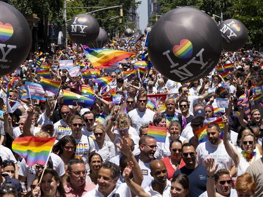 Thousands participate in the LBGTQ Pride march Sunday in New York.