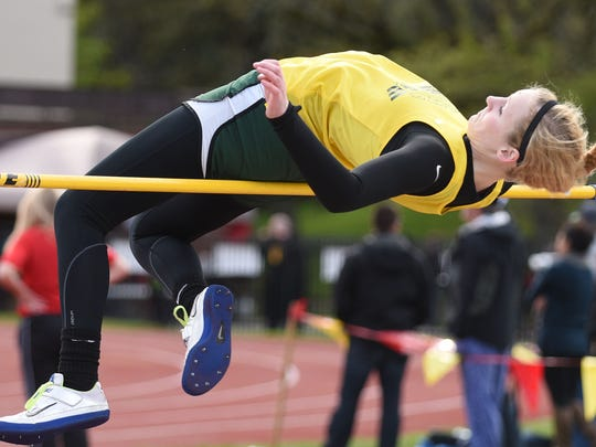 Regis' Monica Webb competes in the high jump during