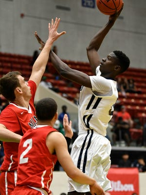 Lahat Thioune shoots in last year's Class 2A boys basketball final against Miami Christian.