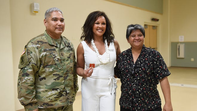 Award-winning singer and actress, Vanessa Williams, with Maj. Gen. Roderick R. Leon Guerrero, poses for pictures with a fan during an event for the StayWell Guam Diabetes Foundation at the Guam National Guard Readiness Center in Barrigada on March 15, 2018.