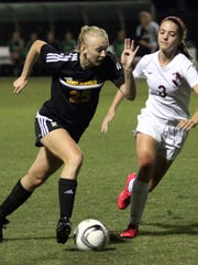 Hendersonville High junior Sydney Cason attempts to