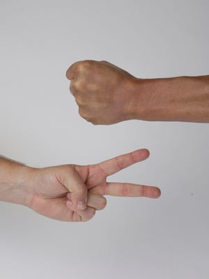 A new study offers insight in how we choose rock, paper or scissors.