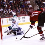 Arizona Coyotes' Martin Hanzal takes a shot on gaol as the Arizona Coyotes face off against the Vancouver Canucks on Wednesday, Feb. 10, 2016, at Gila River Arena in Glendale, Ariz. Hanzal scored on this attempt.