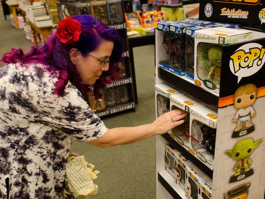 "Toni Maines of Pensacola shops for Funko Pop figures at Barnes & Noble. The shop presents ""Fangirl Friday"" this week."