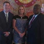 DeSoto teacher Amanda LaFollette has been named a finalist for the Presidential Award for Excellence in Math and Science Teaching. She is shown at a recognition reception with DeSoto Superintendent Dr. Cade Brumley and Mansfield High School Principal Sedric Clark.