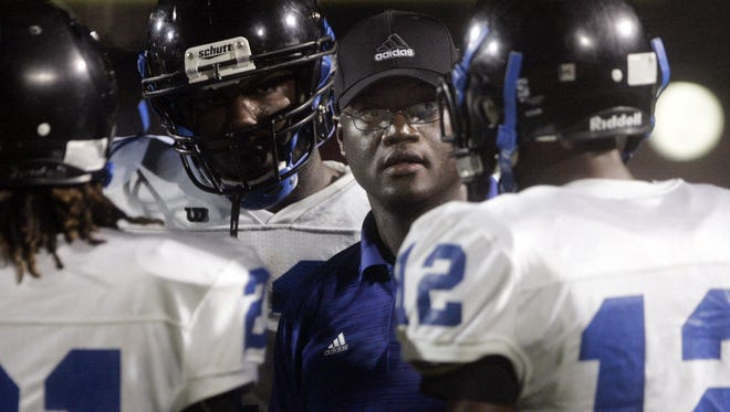 La Vergne head coach Stanton Stevens talks to his players during a time out in the first half at Stewarts Creek Friday, Sept. 6, 2013.