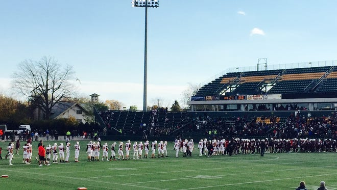 Hilton and Aquinas football teams shake hands after Section V playoff game. Respect is earned on the field and carried off it, writes Leo Roth.