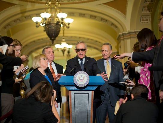 Senate Minority Leader Harry Reid speaks to reporters