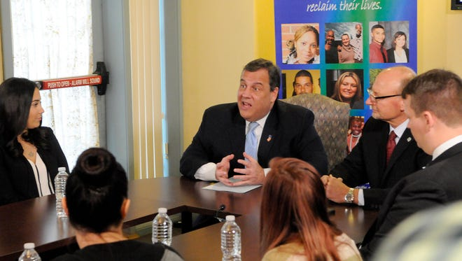 Gov. Chris Christie led a roundtable discussion at Integrity House in Newark, following the signing of an executive order declaring opoid addiction a public health crisis. At right, Integrity House President Robert Budsock. At left is Vanessa, an Integrity House program graduate.