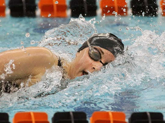 West York's Courtney Harnish swims the 500 yard freestyle finals during the PIAA Swimming and Diving Championships at Bucknell University Saturday Mar. 15 2014. Chris Knight  - For the York Daily Record/Sunday News