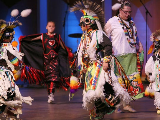 Members of the United Indians of Milwaukee perform
