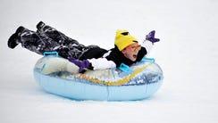 Olivia Rentas slides down the freshly fallen snow at