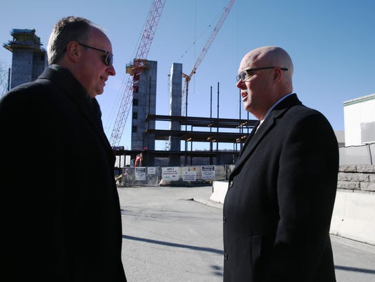 From left, Tim Grom, director of Construction at Health Quest, and John Nelson, director, Public and Community Affairs Vassar Brothers Medical Center, discuss the construction site at Vassar Brothers Medical Center in the City of Poughkeepsie on Thursday, January 25, 2018.