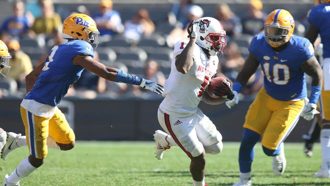 North Carolina State Wolfpack tight end Jaylen Samuels (1) runs the ball against the Pittsburgh Panthers during the fourth quarter at Heinz Field. The Wolfpack won 35-17.