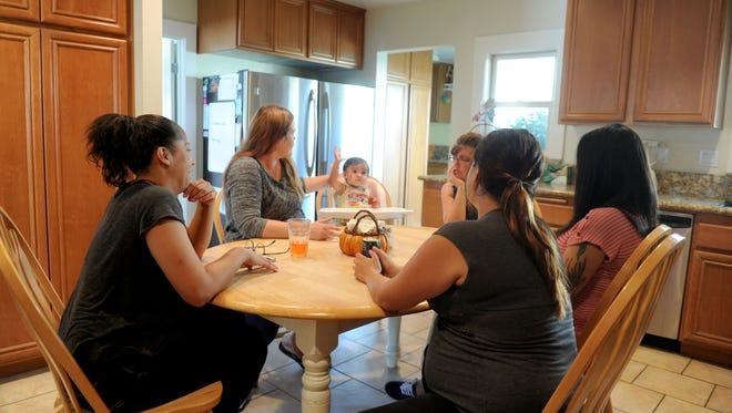 Tender Life Maternity Home in Ventura offers housing for homeless women who are pregnant. Case manager Lauren Stockton (left) discusses dinner plans with Amanda Gracey and her daughter Rylee Gracey; Rebecca Cranham, a missionary for the nonprofit; and residents Nina Figueroa and Taylor May.
