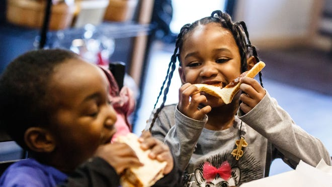 Jeremiah Mack, 3, and his sister D'Saundra, 4, of Milwaukee enjoy lunch at The Peanut Butter & Jelly Deli in West Allis on Saturday, March 3, 2018. The shop offers delicious sandwiches along with serving peanut, almond and cashew butters ground daily and about 100 jams, jellies and spreads on a variety of breads, including gluten-free.