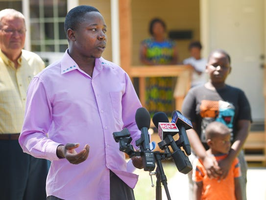 Ndaruzaniye Eliezel talks to news stations out front
