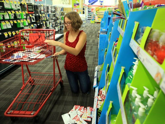 Natalie Shook helps shop for school supplies for foster